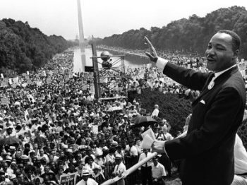 "(FILES): This August 28, 1963 file photo shows US civil rights leader Martin Luther King (C) waving from the steps of the Lincoln Memorial to supporters on the Mall in Washington, DC, during the ""March on Washington"". US President Barack Obama will mark the 50th anniversary of Martin Luther King's ""I have a dream"" speech by speaking from the same steps at the Lincoln Memorial in Washington. The August 28 event in the US capital will take place on the exact spot where King delivered his famous address on the same day in 1963. Obama, the first black US president, will speak about the half century that has passed since the ""March on Washington for Jobs and Freedom,"" which culminated with remarks by the Atlanta pastor and civil rights icon. In 1963 King spoke in front of 250,000 people, explaining his wish for better relations between black and white Americans. His words were engraved on the steps of the monument where he spoke. AFP PHOTO / Files-/AFP/Getty Images"